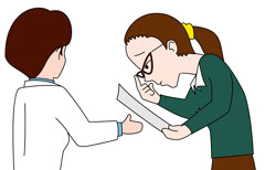 ヘルパーに紙を手渡す視覚障害女性